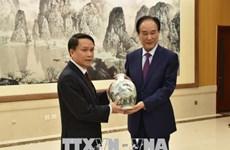 Approfondir les relations de coopération entre la VNA et Xinhua