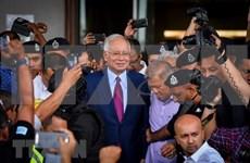 La police convoque l'ex-PM malaisien pour enregistrer sa déclaration