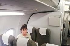 Doan Thi Huong retourne au Vietnam en avion