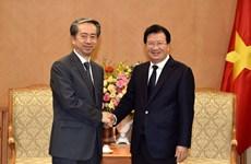 Le vice-PM Trinh Dinh Dung reçoit l'ambassadeur de Chine
