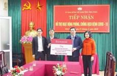 COVID-19: Agribank remet 800 millions de dongs à Vinh Phuc