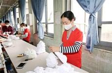Les masques vietnamiens prêts à être exportés aux États-Unis et en Europe