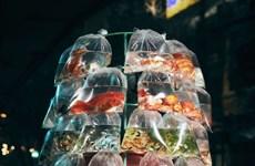Une photo d'un vendeur de poissons d'ornement à moto primée aux Smithsonian Photo Contest
