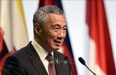 COVID-19 : le PM singapourien remercie le Vietnam pour ses aides