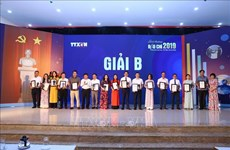 Les lauréats des prix de presse de l'Agence vietnamienne d'Information à l'honneur