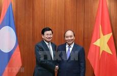 Le Premier ministre lao au Vietnam pour renforcer les liens