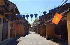 COVID-19 : mise en place de la distanciation sociale dans la ville de Hoi An