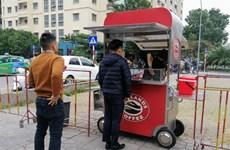 COVID-19 : Les chaînes de café au Vietnam développent la vente à emporter