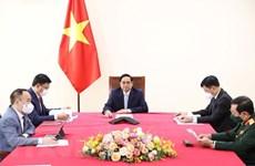 Le PM Pham Minh Chinh tient une conversation en ligne avec le vice-président turc Fuat Oktay