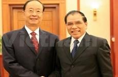 Nong Duc Manh reçoit une délégation du PCC