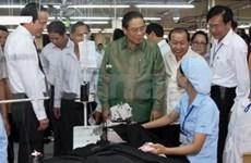 Fin de la visite du président laotien au Vietnam