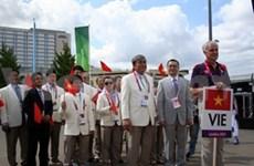Le drapeau du Vietnam hissé au Village olympique