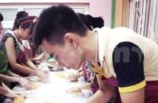 Plus de 2.000 gâteaux de la lune offerts aux enfants pauvres