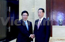 Le vice-PM Pham Binh Minh rencontre son homologue chinois au Guangxi