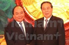 Visite de courtoisie du vice-PM Nguyen Xuan Phuc aux hauts dirigeants laotiens