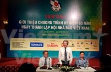 Célébration du 65e anniversaire de l'Association des journalistes du Vietnam