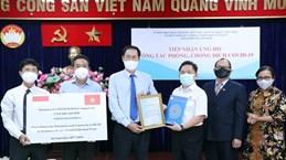 Des étrangers à Ho Chi Minh-Ville soutiennent la lutte anti-COVID-19