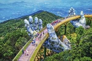 Les médias de masse étrangers font l'éloge du pont d'Or à Da Nang,
