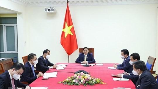 Conversation en ligne entre Pham Minh Chinh et Boris Johnson