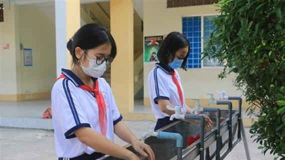 Les élèves de Ho Chi Minh-Ville retournent à l'école au début de mars