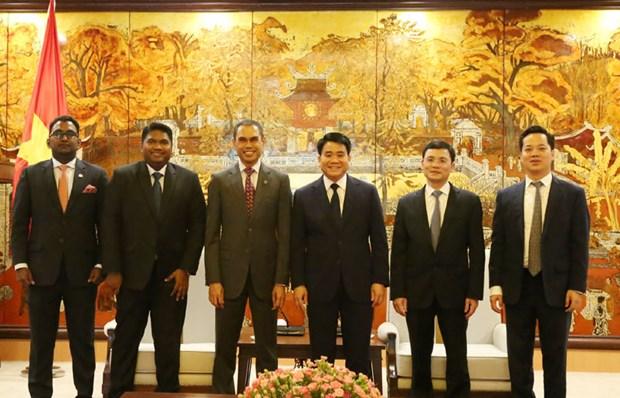 Des groupes et entreprises malaisiens veulent investir a Hanoi hinh anh 1