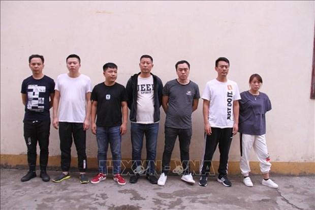 Remise a la Chine sept personnes impliquees dans les jeux d'argent a Lao Cai hinh anh 1
