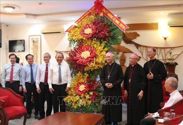 Le vice-Premier ministre Truong Hoa Binh adresse des vœux de Noel a Dong Nai hinh anh 1