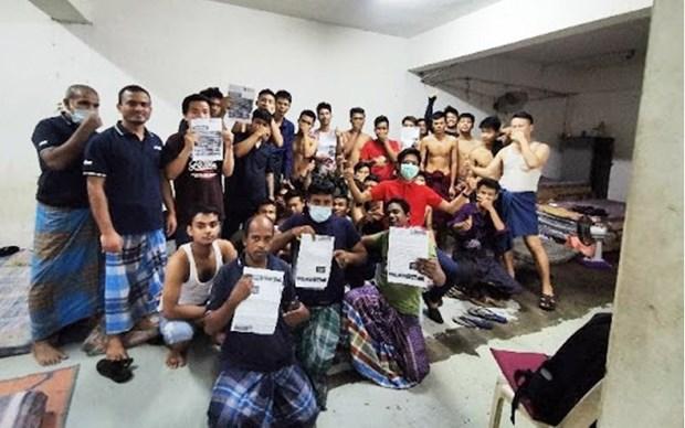 Des travailleurs etrangers en Malaisie confrontes a de nombreuses difficultes en raison du COVID-19 hinh anh 1