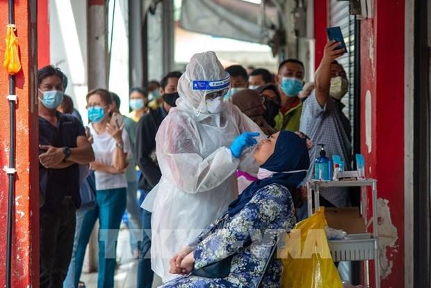 La Malaisie a besoin de 2,4 milliards de dollars pour surmonter la pandemie en 2021 hinh anh 1