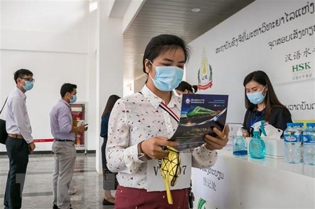 Le Laos appelle a la vigilance de la population pour contenir le COVID-19 hinh anh 1