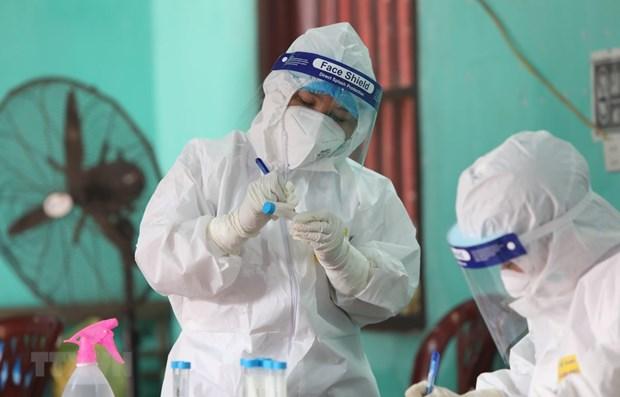 COVID-19: 21 nouveaux cas detectes dans des zones de confinement hinh anh 1