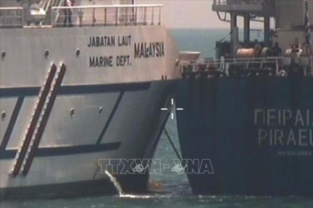 Singapour demande a la Malaisie de rappeler ses navires des eaux litigieuses hinh anh 1