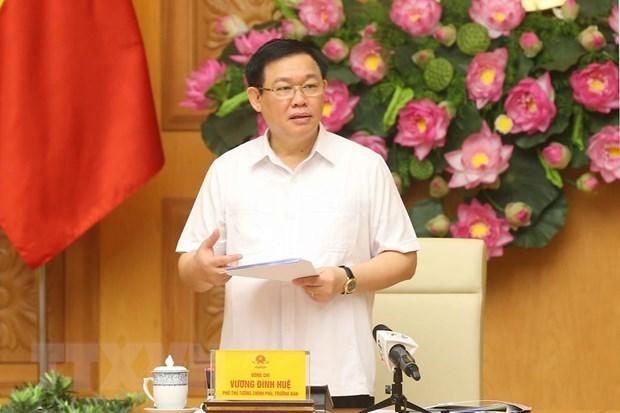 Le vice-PM Vuong Dinh Hue examine l'actionnarisation et la restructuration des entreprises publiques hinh anh 1