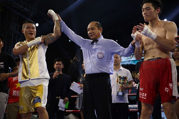 Le boxeur Truong Dinh Hoang remporte la ceinture de la WBA d'Asie hinh anh 1