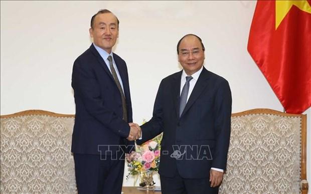 Le Premier ministre Nguyen Xuan Phuc recoit le representant en chef de l'OMS au Vietnam hinh anh 1