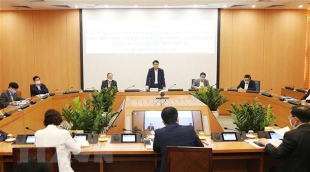 Hanoi elabore 3 scenarios pour attenuer les dommages causes par l'epidemie de COVID-19 hinh anh 1