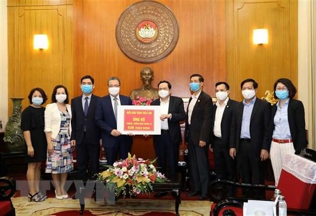 Des Vietnamiens en Thailande et en Republique de Coree soutiennent la lutte contre le COVID-19 hinh anh 1