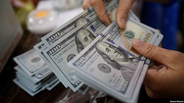 Ho Chi Minh-Ville : 1,8 milliard de dollars de devises transferees en quatre mois hinh anh 1