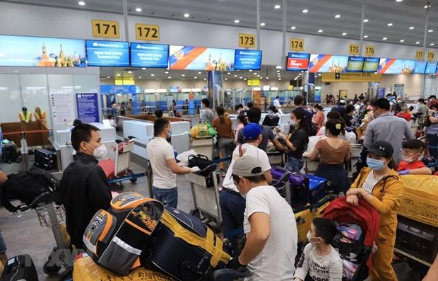 Rapatriement de pres de 300 citoyens vietnamiens de Russie hinh anh 1
