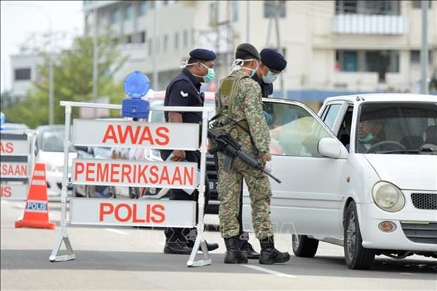 La Malaisie deploie 1.100 militaires a Sabah pour contenir le COVID-19 hinh anh 1
