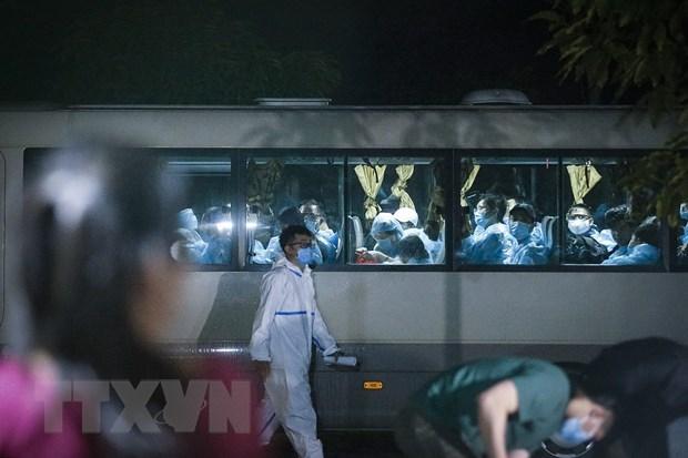 Rapatriement de plus de 240 citoyens vietnamiens de Singapour hinh anh 1