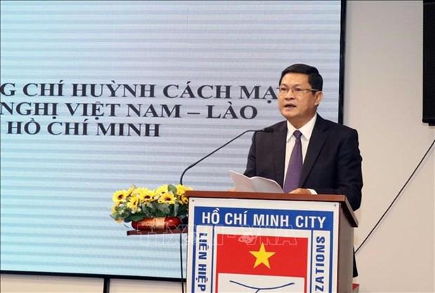 Rencontre a Ho Chi Minh-Ville a l'occasion de la Fete nationale du Laos hinh anh 1