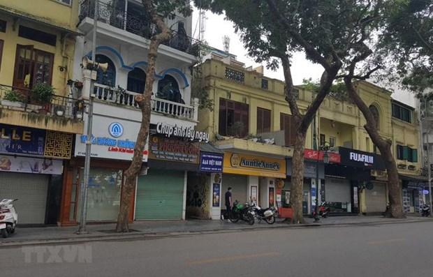 COVID-19: l'interdiction des rassemblements dans les lieux publics a Hanoi hinh anh 1