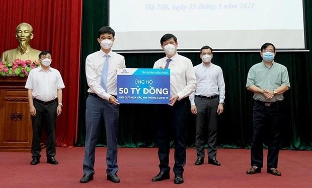 Des entreprises font des dons supplementaires pour le Fonds d'achat des vaccins anti-COVID-19 hinh anh 2