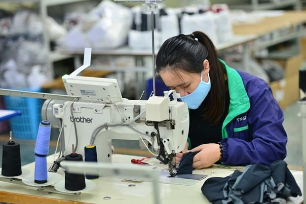 La production d'equipements de protection individuelle au Vietnam a ete multipliee par six en 2020 hinh anh 1
