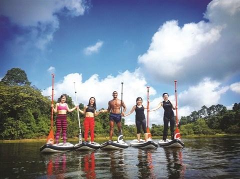 Le stand up paddle sur le fleuve Sai Gon: bonheur garanti! hinh anh 1