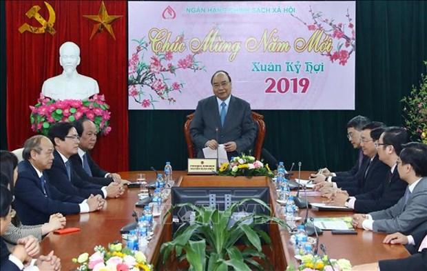 Le Premier ministre felicite la Banque des politiques sociales hinh anh 1