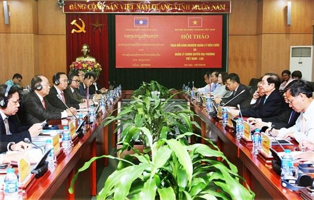 Vietnam et Laos partagent leurs experiences en matiere de gestion des administrations locales hinh anh 1