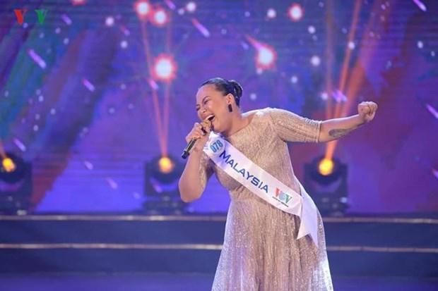 La candidate de la Malaisie remporte le concours de chant ASEAN + 3 hinh anh 1