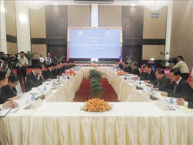 Resserrer la cooperation entre les banques centrales Vietnam - Cambodge hinh anh 1